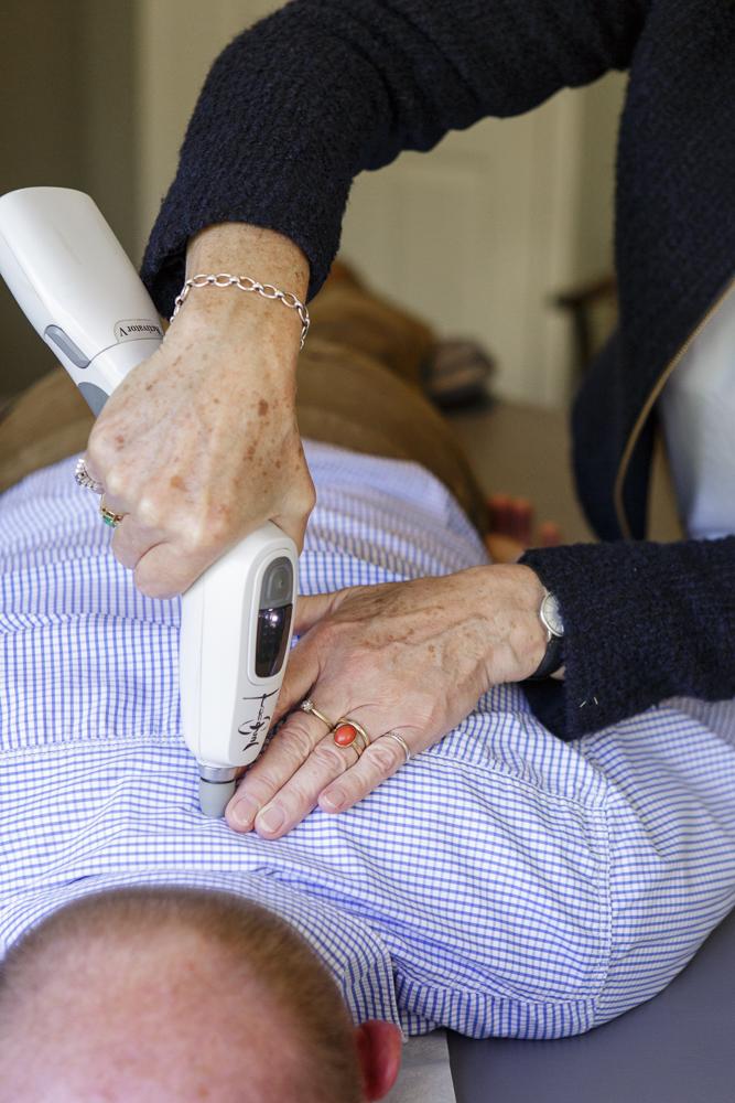 Dr Fowle adjusts a patient